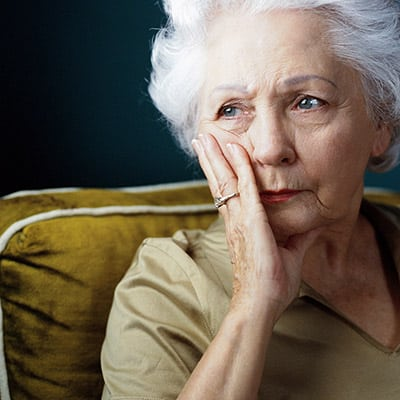 older woman contemplate pension