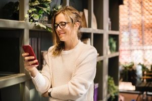 woman using online banking on mobile phone