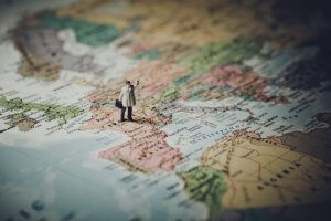 figurine of a man on a map