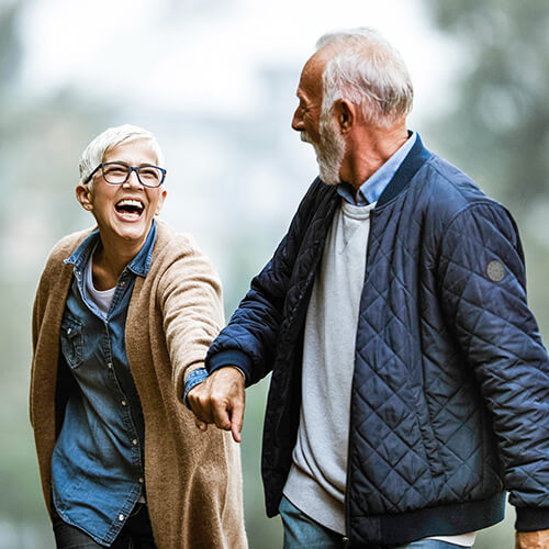 Happy older couple considering pension
