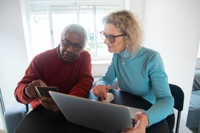 A couple looking up information on their pensions